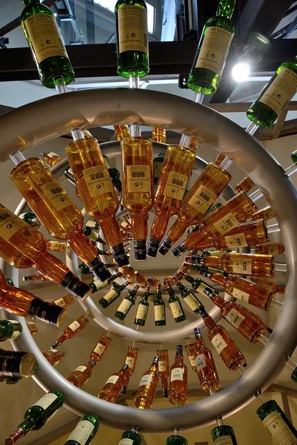 216-20160726_The Glenlivet Distillery-Banffshire-Visitor Centre-display of malt whisky bottles-detail
