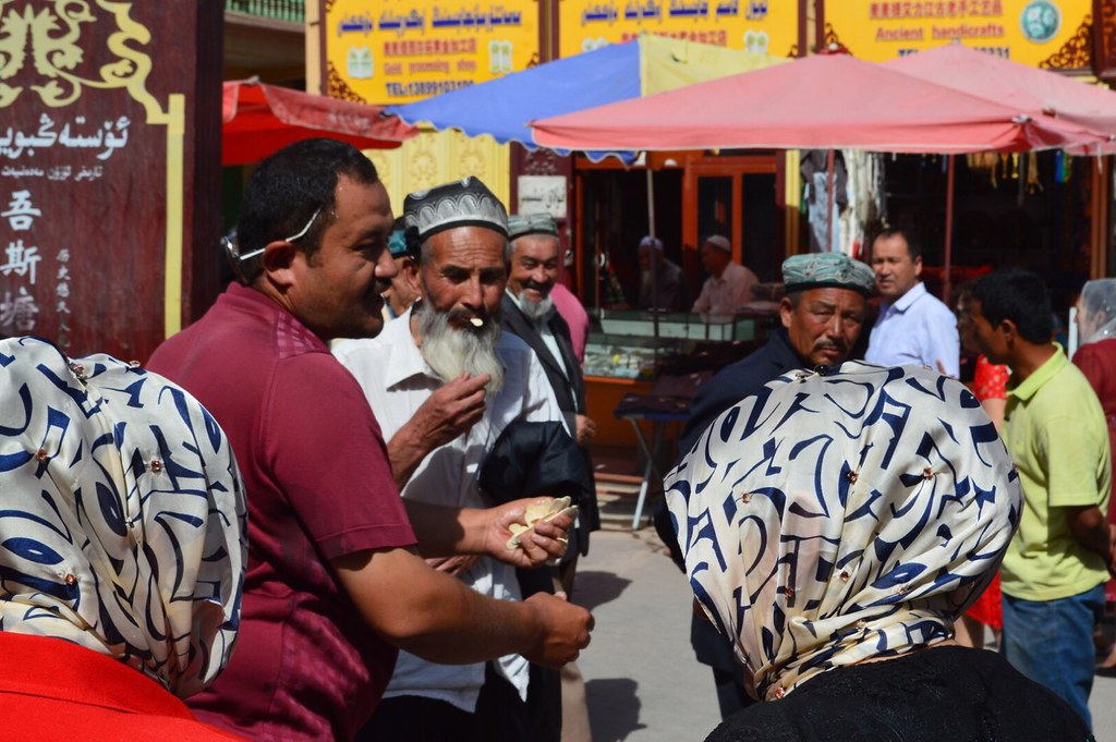 Man selling honey in the streets of the old town in Kashgar