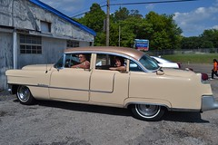 Tad and my wife in his Fifties Cadillac outside Bobo's Catering Service Memphis TN
