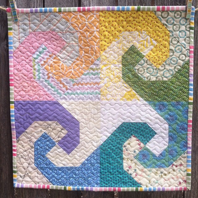 My #rainbowminiswap quilt has finally made it's way to @kelcieo in Hawaii. Hurray! I had so much fun putting it together. Kelcie mentioned she liked muted, pastel colors and a beachy theme. I made rainbow waves in soft colors and I love how it turned out.