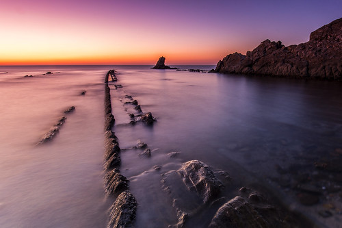 ocean longexposure morning sea sky orange sun seascape beach water lines sunrise reflections landscape dawn rocks waves shadows horizon tripod shoreline cadiz bluehour algeciras blackcard purplelight transparentwater canonef1635mmf4lisusm canoneos6d puntadelcarnero neutralgraduated3stepsfilter
