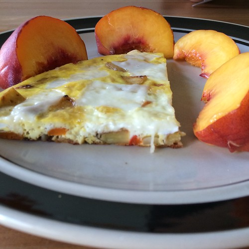A quarter of an almost Spanish tortilla, surrounded by peach slices. Because it is still peach season, yay!!!