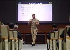 Command Master Chief Jason Knupp speaks during a combined U.S. and Republic of Korea chief petty officer training symposium, Oct. 6. (U.S. Navy/MC1 Abraham Essenmacher)