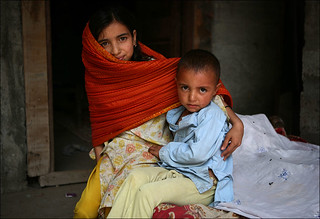 Two orphan children beneficiaries of Hashoo Foundation's cow distribution project.