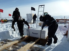 Moving the ice cores up out of the core storage trench to ready them for transport to McMurdo Station.