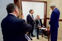 U.S. Secretary of State John Kerry chats with State Department Chief of Staff Jon Finer and Special Envoy for Israeli-Palestinian Negotiations Frank Lowenstein before addressing reporters on November 24, 2015, following his meeting with Palestinian Authority President Mahmoud Abbas at the Muqata'a Presidential Compound in Ramallah, West Bank. [State Department photo/ Public Domain]