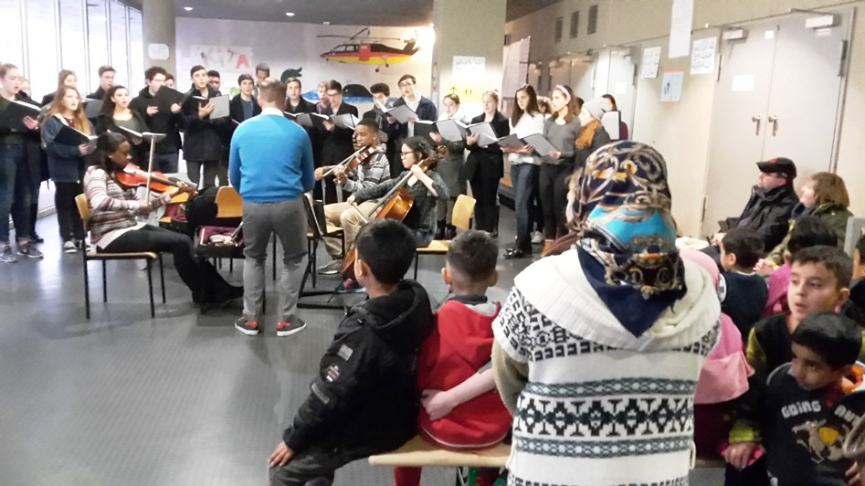 Georgetown Day School Chamber Choir performs for refugees in Berlin