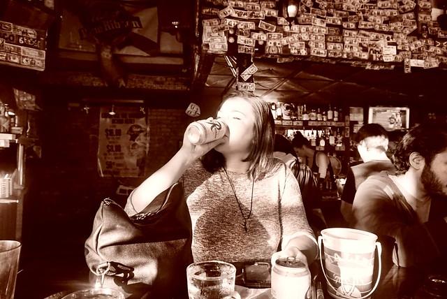 A girl enjoying her beer