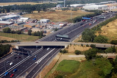 highway, bird's-eye view, transport, road, lane, controlled-access highway, residential area, overpass, aerial photography, infrastructure,