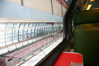green vinyl, red table and ash tray inside Dutch train