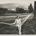 Young girl sits in a hammock by simpleinsomnia