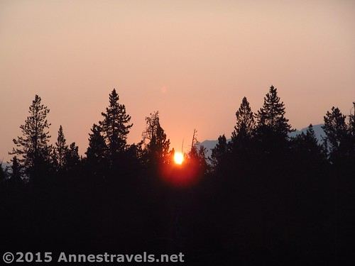 The sun rises in a smoke-filled sky along the Big Sandy Trail, Wind River Range, Wyoming