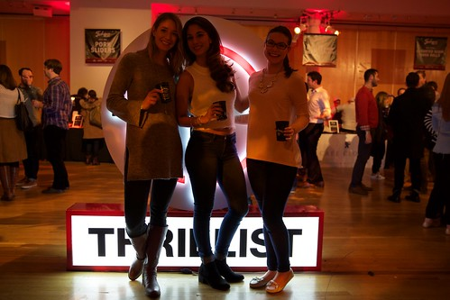 Guests posing in front of Thrillist sign