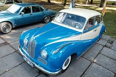 automobile(1.0), vehicle(1.0), automotive design(1.0), bmw 501(1.0), mid-size car(1.0), compact car(1.0), antique car(1.0), sedan(1.0), classic car(1.0), vintage car(1.0), land vehicle(1.0), luxury vehicle(1.0), motor vehicle(1.0),