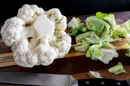 removing the leaves from the cauliflower