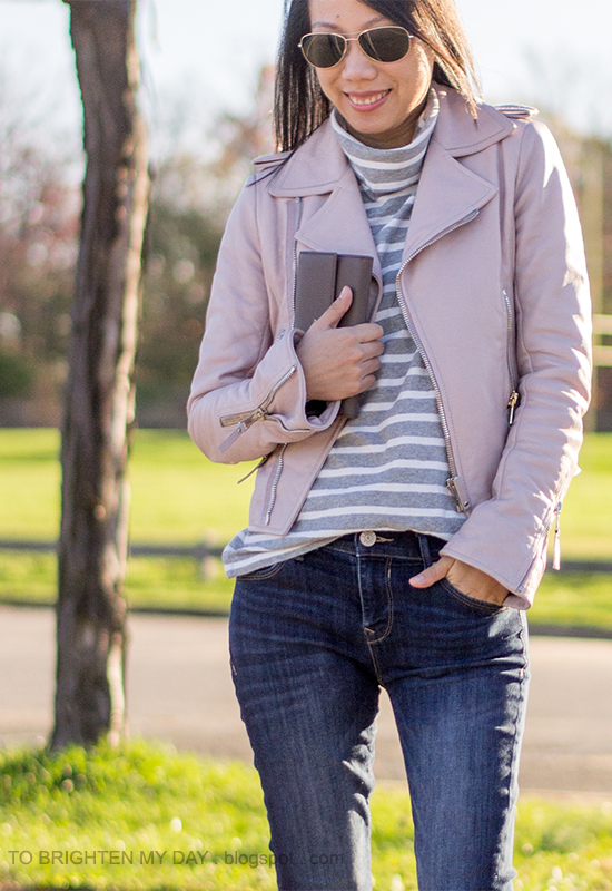 lilac leather jacket, gray striped turtleneck, jeans, taupe clutch