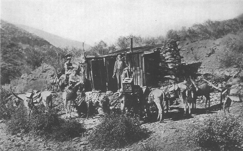 Old cabin at Heaton Flats Mine. Pictured left to right: Ralph Follows, E.V. Lucas, William T. Heaton