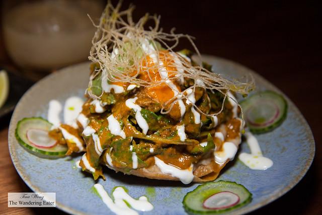 Rabbit Mole Tosada - pepper chutney, salsa verde, cacao, yuzu-cilantro-yogurt crema, mizuna