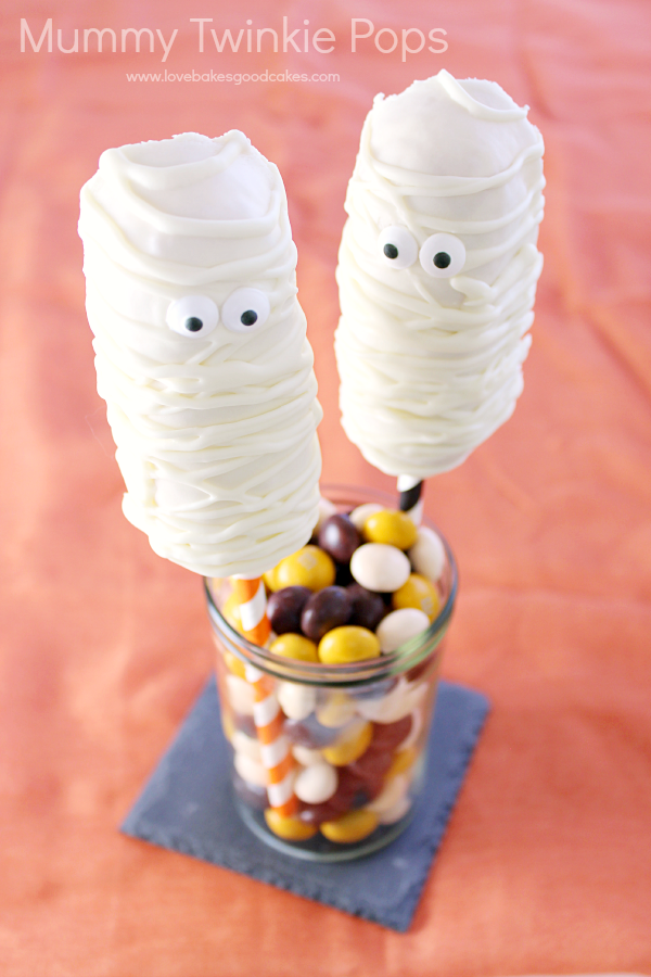 Get creative with your Halloween treats and make these Mummy Twinkie Pops! They're so simple and kids love them!