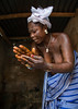 Benin, West Africa, Bopa, mrs hounyoga prays the twins spirits in the dan temple by Eric Lafforgue