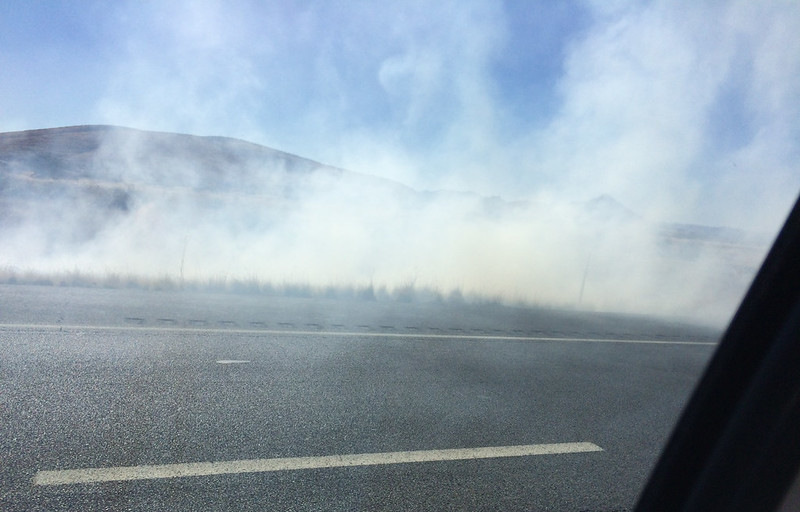 Glassford Hill Behind Smoke from Fire on 89A