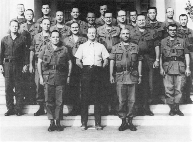John Paul Vann (white shirt) and his staff at their Pleiku headquarters
