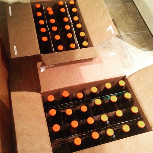 "Packaged 46 × 12 oz. bottles of ""Flaming Hessian"" - a chili-pumpkin ale. Not *quite* as much heat as if have liked (but was afraid we'd have overdone it too) -- it'll be serviceable for the Halloween party though. FG 1.010 → 5.6% ABV 🎃:beer"