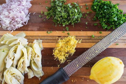 zesting the lemons, chopping the herbs