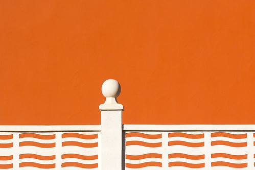 White fence and orange wall (on Explore)