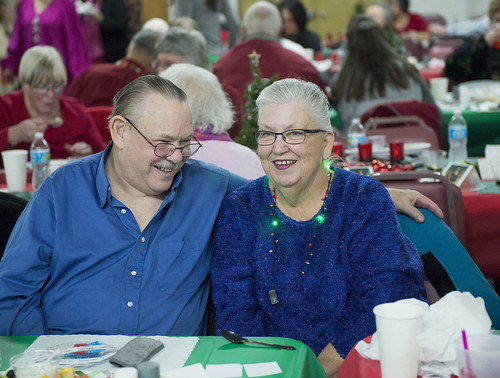Jake Gibbs and Bonnie Juliussen share a laugh at the Tyotkas Elder Center Christmas party.