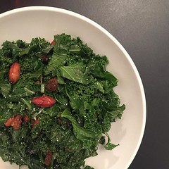 Kale salad with raisins, almonds, and honey vinaigrette.