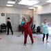 Ageless Action Seniors at Lenox Hill Senior Center do flexibility exercises