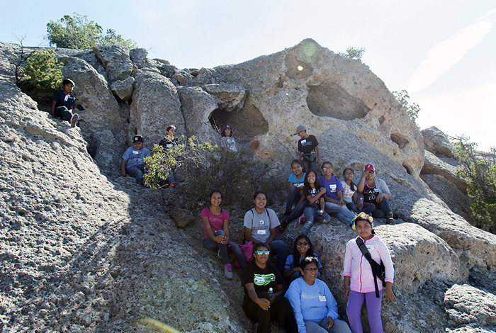 Students from the San Ildefonso Pueblo Summer Education Enhancement Program recently toured Cave Kiva in the Mortandad Canyon at Los Alamos National Laboratory. The Summer Education Enhancement Program has also provided students with visits to Bandelier National Monument and Bradbury Science Museum's archaeological exhibits to promote the connection of science and culture.