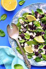 Spinach salad with beet root and feta cheese.