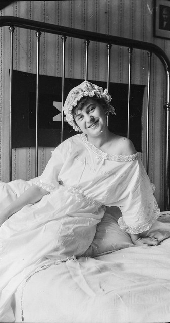 Smiling woman wearing a nightgown