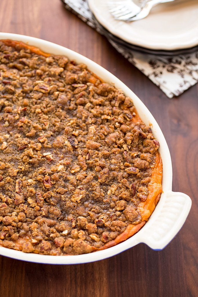 sweet potato casserole with pecan praline topping in a gratin dish