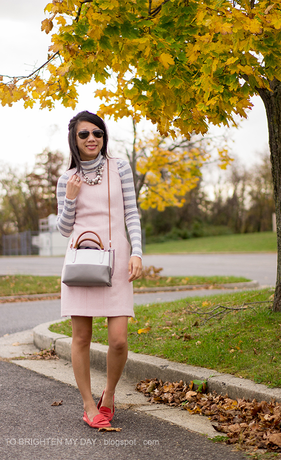 gray striped turtleneck, mixed pearl necklace, pink wool dress, colorblocked crossbody bag, red loafers
