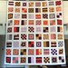 finished! mod sampler quilt by pandaparables