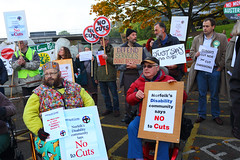 Disabled people protesting outside Norfolk County Hall against Norfolk County Council cuts to services A3 roughly