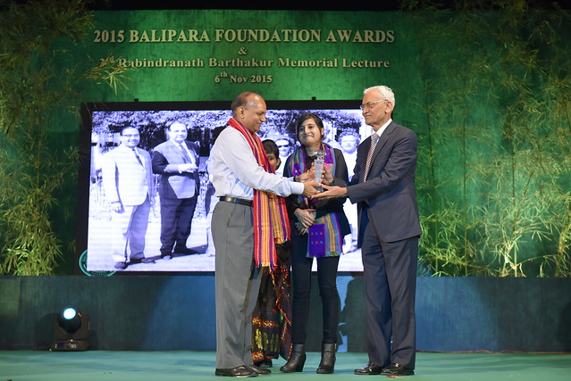 Mr. R.S. Jhawar (Williamson Magor) receiving the Lifetime Service Award on behalf of Mr. Brij Mohan Khaitan from The Honorable Chief Secretary to Government of Assam