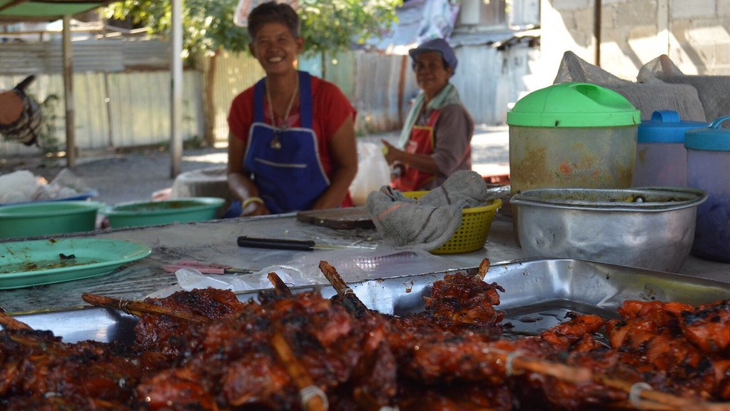 Friendly woman's along the road - street food