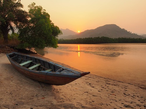 sierraleone beach rivernumber2 sand boat westafrica sunrise sun sky mountains orange travel traveldestination