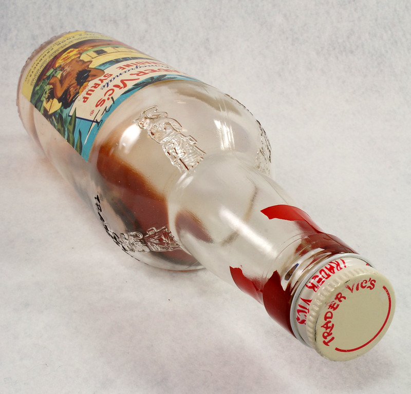 RD15320 Vintage Mid Century 1946 Bottle of Trader Vic's Pomegranate Grenadine Syrup with Topless Girl Tiki DSC09140