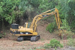 logging(0.0), agriculture(0.0), soil(1.0), vehicle(1.0), tree(1.0), construction equipment(1.0), bulldozer(1.0),