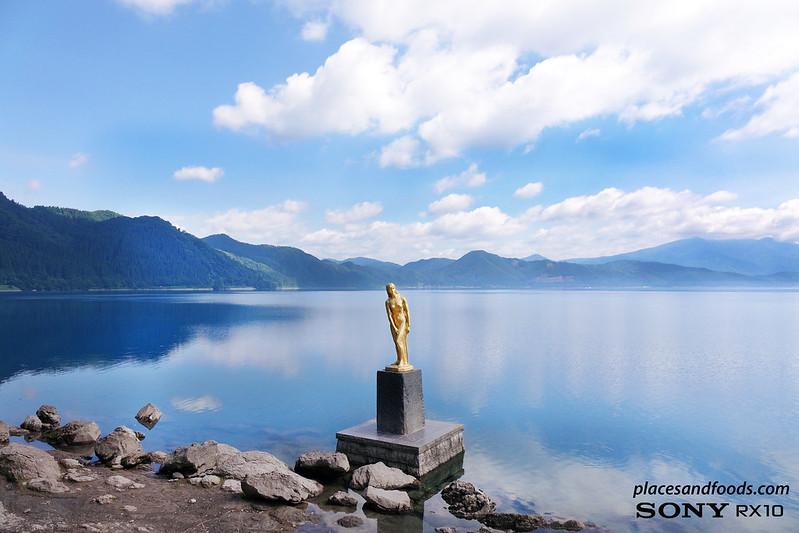 akita tazawa lake with tatsuko statue