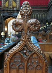 Bench end with poppyhead, Gloucester Cathedral choir, Gloucester, England