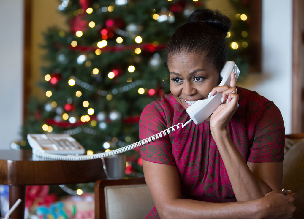 <p>First Lady Michelle Obama reacts while talking on the phone to children across the country as part of the annual NORAD Tracks Santa program. Mrs. Obama answered the phone calls from Kailua, Hawaii, Christmas Eve, Dec. 24, 2016.<br /> (Official White House Photo by Pete Souza)<br /> <br /> This official White House photograph is being made available only for publication by news organizations and/or for personal use printing by the subject(s) of the photograph. The photograph may not be manipulated in any way and may not be used in commercial or political materials, advertisements, emails, products, promotions that in any way suggests approval or endorsement of the President, the First Family, or the White House.</p>
