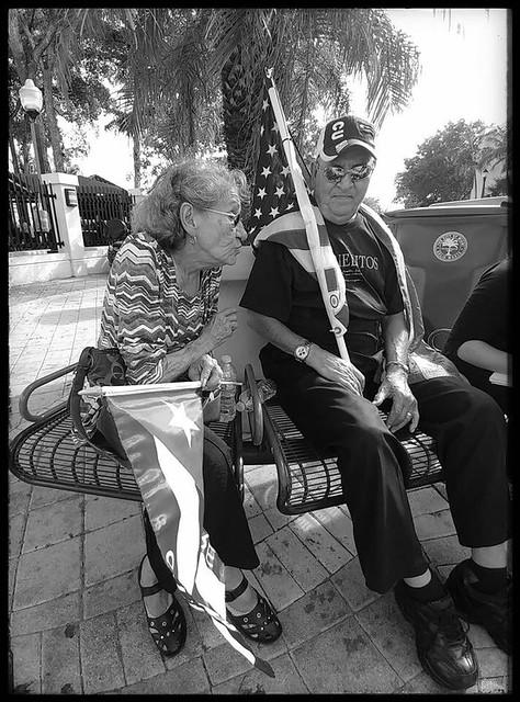 Couple with flags. Domino Park, Little Havana, Miami,FL.