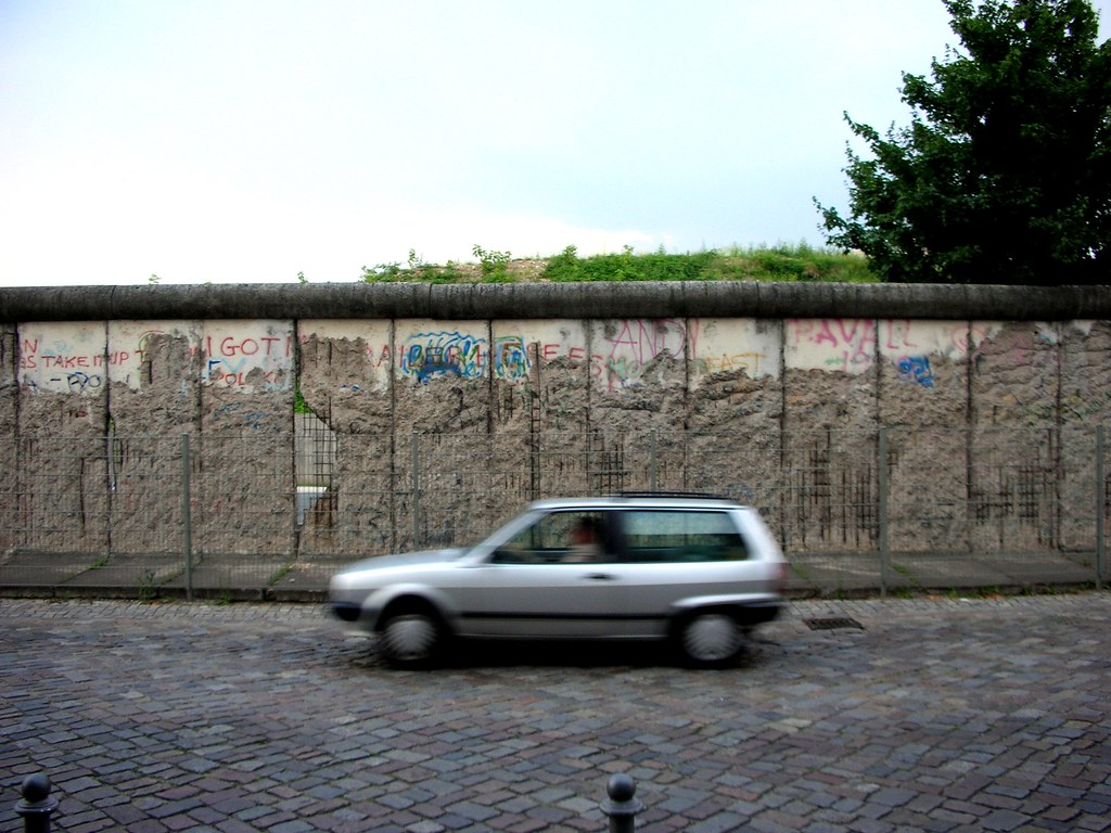 Car Passing By Section of the Berlin Wall