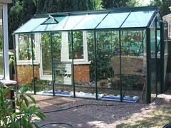 canopy(0.0), tool(0.0), orangery(0.0), greenhouse(1.0), backyard(1.0), outdoor structure(1.0), garden(1.0), yard(1.0), gazebo(1.0), shed(1.0),